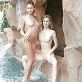 Ariana and Tali play with each other poolside, until a big cock arrives - image