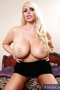 Mega Busty Cougar Looks For Some Cum