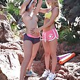 Two hot babes Licking Each Other Out Under The Sun - image