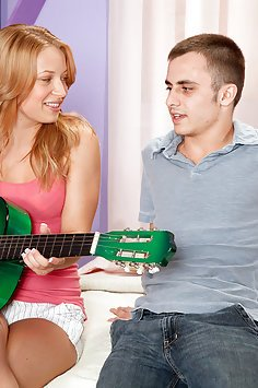 Stumming Her Guitar and Clit