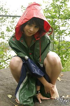 Teen Plays In the Rain