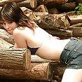 Ariel Rebel plays with wood - image